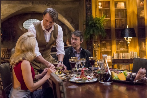 "HANNIBAL -- ""Antipasto"" Episode 301 -- Pictured: (l-r) Gillian Anderson as Dr. Bedelia Du Maurier, Mads Mikkelsen as Dr. Hannibal Lecter, Tom Wisdom as Anthony Dimmond -- (Photo by: Brooke Palmer/NBC)"
