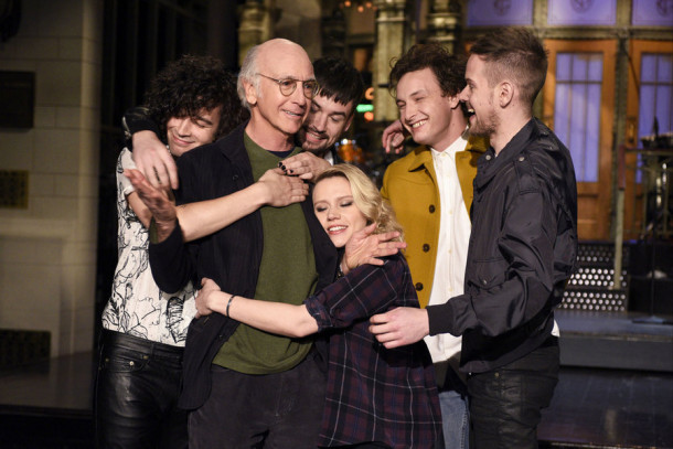 "SATURDAY NIGHT LIVE -- ""Larry David"" Episode 1695 -- Pictured: (l-r) Matthew Healy, Ross MacDonald, George Daniel, and Adam Hann of musical guest The 1975 surround actor Larry David and actress Kate McKinnon on February 4, 2016 -- (Photo by: Dana Edelson/NBC)"